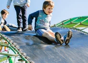 child playing on slide in merrifield