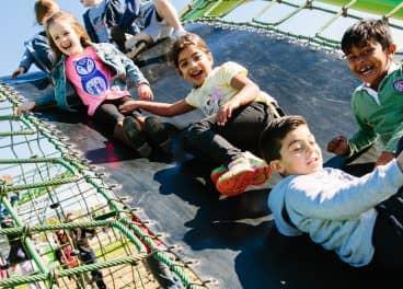 children playing on slide in merrifield