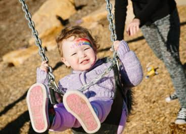 child on swing in merrifield